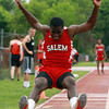 Salem sophomore Aaron Palmer soars through the air during the long jump against Beverly on Tuesday afternoon. David Le/Staff Photo