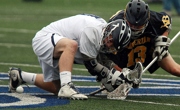 St. John's Prep centerman Derek Osbahr, left, battles for control of a faceoff with Xaverian's Cam Murphy, right, on Tuesday afternoon. David Le/Staff Photo