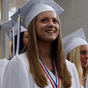 Swampscott High School Senior Class Secretary Katie Zarinsky smiles up at her family as she marches into graduation on Sunday afternoon. David Le/Staff Photo