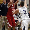 Masco's Adam Bramanti (3) left, lines up a three point shot as Hamilton-Wenham's Jake Lindland (3) runs out to apply pressure. David Le/Salem News