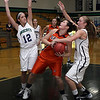 Salem State's Breanna Comeau, center, tries to control the ball while being pressured by Endicott's Jordan Ferland (12) left, and Sarah Robinson (25) right. David Le/Salem News