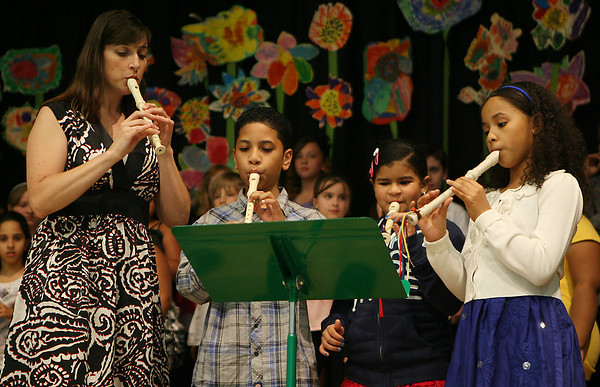 Bentley School music teacher Erin Cherry, left, plays a quartet with her third grade students, Edwin Coriano, Anabell Diaz, and Maria Cespedes, during the spring concert on Tuesday evening. David Le/Staff Photo