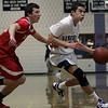 Hamilton-Wenham guard Stephen Tam (5) right, drives to the lane against Masco's Chris Schleer (12) left. David Le/Salem News