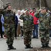 Brian Reid, left, of Lynnfield, leads in the singing of the National Anthem next to Chaplain Major Robert Ebersole, center, and Lieutenant Colonel Thomas Lyons, of the Beverly Civil Air Patrol at a Wreaths Across America presentation on Saturday morning at St. Mary of the Annunciation Cemetary in Danvers. David Le/Salem News