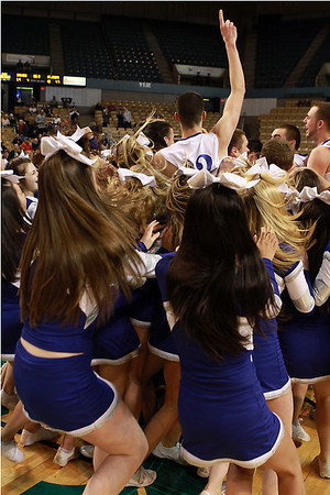 The Danvers High School Cheerleaders and Danvers High Basketball Team celebrate at center court at the DCU Center in Worcester after the Falcons brough home their first ever D3 State Basketball Title. David Le/Staff Photo