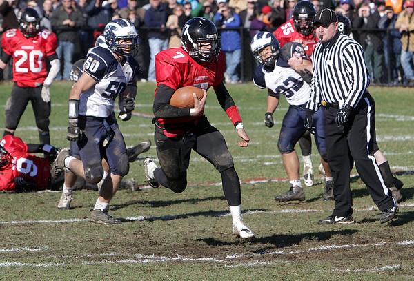 Marblehead quarterback Ian Maag (7) breaks free for a big gain against Swampscott on Thursday morning. David Le/Salem News