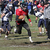 Marblehead quarterback Ian Maag (7) breaks free for a big gain against Swampscott on Thursday morning. David Le/Salem News