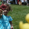 Danvers: Molly Godfried, age 4 of Danvers, is all concentration as she hurls a beanbag towards a row of rubber ducks at Endicott Park Day held on Saturday afternoon in Danvers. Photo by David Le