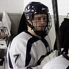 St. John's Prep defenseman Leo Sutera (7) taps each of his teammates helmets before hitting the ice. David Le/Staff Photo