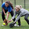 Pingree junior Alex Kruck, left, and senior Victoria DaMore, right, battle for a ground ball during pepper at practice on Wednesday. David Le/Staff Photo
