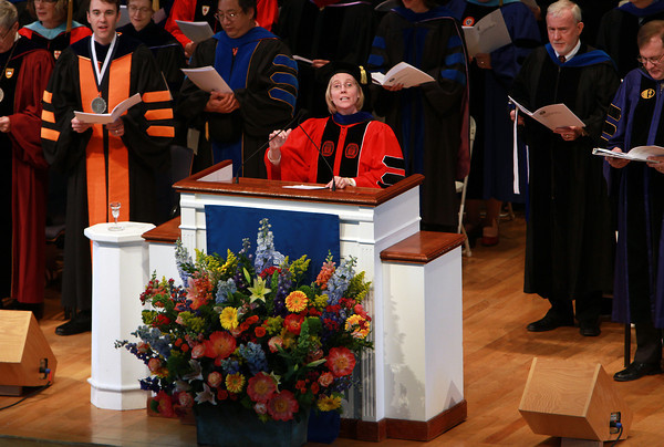 Sandra Doneski, Associate Professor of Music at Gordon College, leads those gathered for the Baccalaureate Service in an Opening Hymn on Friday afternoon. David Le/Staff Photo