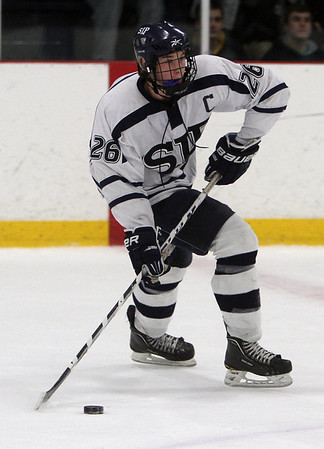 St. John's Prep junior captain Brian Pinho (26) dangles with the puck against Austin Prep. David Le/Staff Photo