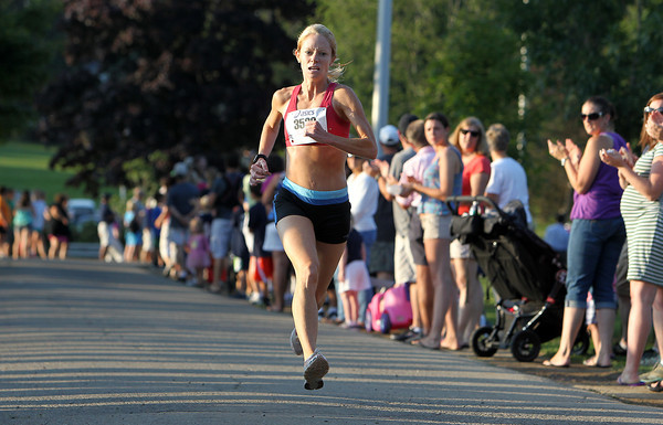 Layce Alves, of Rockport, is all by herself as she comes into the finish line of the 45th Annual Beverly Homecoming Race on Thursday evening. David Le/Staff Photo