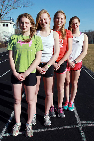 The Hamilton-Wenham 4x800 relay team from left, sophomore Emily Horgan, freshman Emily Weigand, junior Meg Blatchford, and senior Emily Senning, will be competing in the New Balance Nationals meet in New York City on Saturday night. David Le/Staff Photo