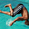 Javier Robles, 14, of Salem, winces as he flips into the pool at Forest River Park in Salem on Tuesday afternoon. David Le/Staff Photo
