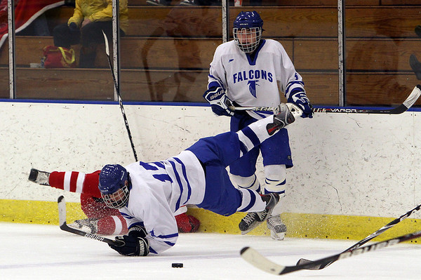 Salem: Danvers' Paul D'Orlando takes a spill after being tripped up by a Saugus defender. David Le/Salem News