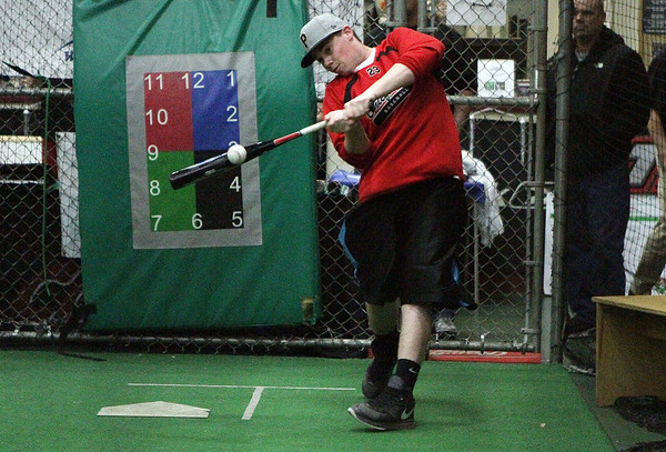 Joe Klingensmith, a sophomore at Masco High School tries out a new bat at Extra Innings in Middleton on Thursday night. David Le/Salem News