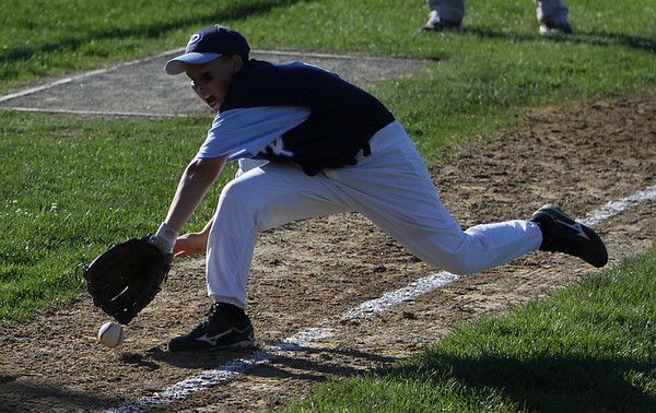 Peabody: Peabody National thirdbaseman Anthony Hartnett grimaces as he attempts to make a diving catch along the thirdbase line in Peabody's Wednesday evening game against Danvers National at Cy Tenney Park in Peabody. Photo by David Le/Salem News
