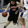 Beverly's Andrea Zelano (30) left, drives to the hoop against Peabody's Olivia Summit (41) right. David Le/Salem News