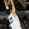 Danvers senior George Merry dunks the ball in the final minute of the D3 State Championship at the DCU Center in Worcester, putting a stamp on the Falcons' victory. David Le/Staff Photo