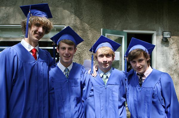Waring School seniors Gus Egan, of Marblehead, Gus Mosse, of Gloucester, Thomas Adam, of Wenham, and Will MacEwen, of Beverly, pose for a photo before their Commencement Ceremony on Friday afternoon. David Le/Staff Photo