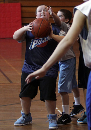 Curtis Twombley looks to pass to a teammate during a PBA basketball game on Saturday morning. David Le/Salem News