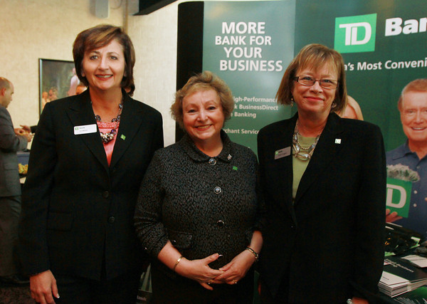 From left, Liz White, Regional Marketing Manager of TD Bank, Paula Bishop and Eileen Duggan, at the Beverly Business Showcase on Thursday evening. David Le/Staff Photo