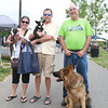 Christine Gomes and Raymond Lefevre, of Peabody, and their dogs Olivia and Oreo, left, and Don Armell, of Salem, and Fidelco Guide Dog Lotse, at a Fundraiser for Salem Play Areas for Canine Exercise on Saturday morning. David Le/Staff Photo