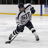 St. John's Prep defenseman Zach Fuller (17) rips a shot on net against Austin Prep. David Le/Staff Photo