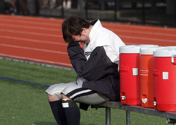 Hamilton-Wenham quarterback Trevor Lyons is overcome with emotion after the Generals were defeated by Bourne High School in the EMass Division IIIA Superbowl on Saturday afternoon. Lyons was injured after throwing a touchdown pass and was forced to miss the second half. David Le/Salem News