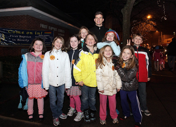 Beverly: Some New Year's Eve participants stop by the First Baptist Church for a photo on Saturday night. David Le/Salem News