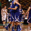 Danvers senior George Merry, left, gets a hug from senior Paul Nicolo, as time ticks down in the 4th quarter of play, sending Danvers to the D3 State Final with a 68-45 win over Wareham on Monday afternoon at the TD Garden. David Le/Staff Photo