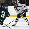 St. John's Prep sophmore defenseman Ean Mendeszoon (6) right, lines up a shot from the point. David Le/Staff Photo