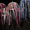 From left, Liz Lobsitz, Michelle Battista, and Deb Lobitz, dance around Washington St. as jellyfish on Halloween Night. David Le/Staff Photo.