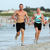 Brian Nelson, left, of East Hampton, and Alex Edwards, of Ipswich, run down Crane's Beach during the Ipswich YMCA's Triathalon on Friday evening.David Le/Staff Photo