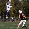 Swampscott wide receiver AJ Baker (1) leaps up high to snag a pass from quarterback Mike Walsh as Beverly's Kenny Pierce (28) closes in. The Big Blue defeated the Panthers 21-13 on Saturday afternoon. David Le/Salem News