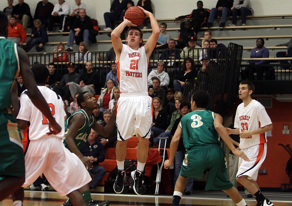 Beverly: Beverly's Cam Rogers (20) center, drains a three-point shot against Lynn Classical on Tuesday night. David Le/Salem News