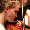 Beverly High School freshman Maeve Monahan concentrates as she plays a piece with the string ensemble during the Spring Concert on Thursday afternoon. David Le/Staff Photo