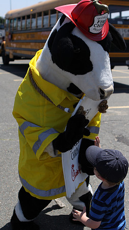 Danvers: Calvin Campbell, 2 1/2, of Peabody, high fives the Chick-Fil-A cow at the Touch-A-Truck Day held at the Liberty Tree Mall in Danvers, as part of the Danvers Family Festival. Photo by David Le/Salem News