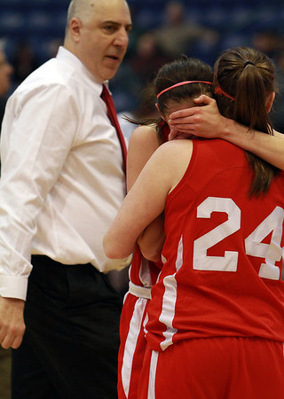 Masco head coach Bob Romeo, left, can only watch as Masco sophomore Lexie Nason (24) right, consoles her sister, senior Chelsea Nason, following a loss to Andover in the D1 North Final at the Tsongas Center. David Le/Staff Photo