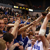 Danvers senior captain George Merry hoists the D3 State Championship trophy high for all of Danvers Nation to see following a victory over St. Joseph's to capture the State Title for the first time in school history.. David Le/Staff Photo