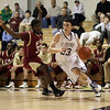 St. John's Prep senior Owen Marchetti (23) drives past BC High's Standy Merizier (33) on Friday night,. David Le/Salem News