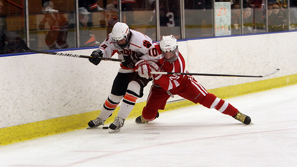 Beverly's Brendan Mitchell (10) left, locks up with Saugus' Steve Russo (21). David Le/Staff Photo