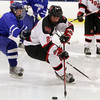 Marblehead's Zac Cuzner (27) right, protects the puck against a Danvers player. David Le/Salem News