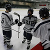 St. John's Prep sophmore Ean Mendeszoon (6) and senior John Ryan (2) congratulate junior captain Brian Pinho (26) center, after scoring a goal. David Le/Salem News