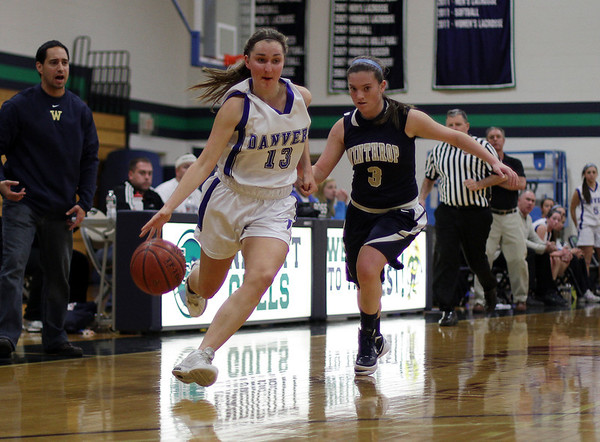 Beverly: Danvers' Katie McKenna drives right past a Winthrop defender on Thursday night at Endicott College. David Le/Salem News