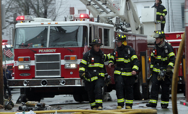 Peabody: Members of the Peabody fire department try and put out a 3-alarm fire with the help of a few neighboring fire departments on Friday afternoon. David Le/Salem News
