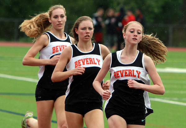 Beverly High School sophomore Jessica Goodall, right, sophomore Keely Higgins, center, and junior Madison Shropshire, left, compete in the mile on Tuesday afternoon. David Le/Staff Photo