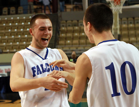Danvers junior Nick McKenna, left, and senior Jon Amico, right, celebrate following a victory over St. Joseph's on Saturday to earn the Falcons their first ever State Basketball Title. David Le/Staff Photo