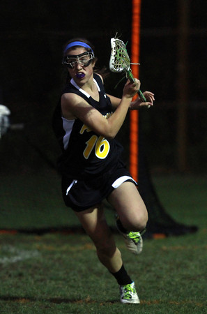 Bishop Fenwick's Natalie Emerson (16) races the ball upfield against Peabody on Friday evening. David Le/Staff Photo